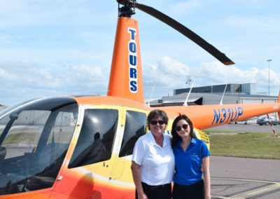 Stella and Raeven from our marketing team visiting our helicopter out of downtown St. Petersburg